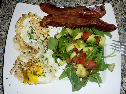 Fried egg with arugula salad
