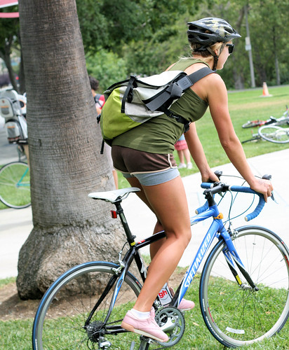 Girl in shorts on bicycle