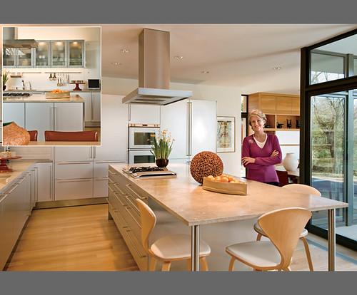 Warm + modern kitchen: White cabinets + limestone counters + white oak floors