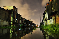 Flooded Homes Along the Rails (michaeljosh) Tags: poverty longexposure nightshot philippines manila floods sampaloc project365 squattersarea tamron1750mmf28 nikond90 submergedrailroads