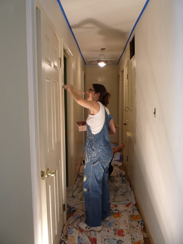 Amy painting the walls in the hallway. by you.