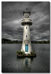 The Clocktower (Roger.C) Tags: park sky lighthouse lake reflection tower clock water wales clouds cardiff dramatic hdr wfc roath superaplus aplusphoto infinestyle platinumheartaward