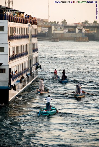 Vendors in small boats close on cruise ships at the Esna Dam locks on the Nile River in southern Egypt.