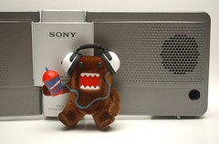 DOMO and his tunes (kingkong21) Tags: domo 711 slurpee