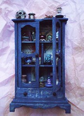 Miniature Archaeologist Cabinet ~ 1:12 Scale (Enchanticals~ Death in Family) Tags: wood glass skull miniature furniture handmade stamps feather books photograph frame bones postal collectible bookcase homedecor artifacts digs dollhouse dioramas crystalball jinn scrolls littlethings archaeologist expeditions oneinchscale etsylove roomboxes 112thscale dollhouseminiature onetwelfthscale etsyartists etsyteams minimakers dontmakeascene miniaturedoors damteam scaledollhouseminiature teammids jinnbottle enchanticals miniaturedollhousescale minitreasures handcraftedminiatures enchanticalsetsy cabinetwithdoors miniaturesindollhousescale miniaturecollector 112scaledollhousescale dollhousesandminiaturesforthem addictedtominis miniaturesgeneral alteredboxesminiatures etsysellersonflickr estsyhandmadeandvintage
