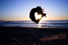 A Dancer's Story (Sarah Ching) Tags: ocean blue light sunset sea sky sun love beach water silhouette set dance jump sand heart profile dancer explore gradient prints selling pints prange cjump explored sellingprints tumblr trisarahhtops