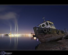 The Specter ship (ALtammar Q8) Tags: new longexposure reflection night canon reflections boat factory ship smoke seashore 2009 factories specter 2470mm seeline 40d altammar