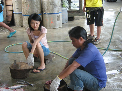 Lead actress Fei Ling taking lessons in cutting salted fish