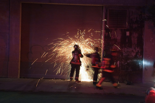 Firefighters use a saw to open a door for access