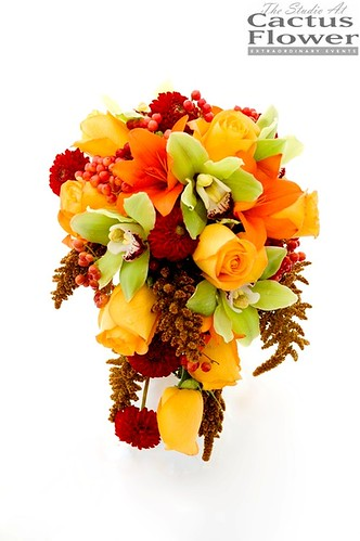 Here 39s a lovely fall wedding bouquet cascading with roses and orchids and