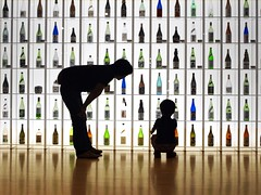 Which is your pick? (tanakawho) Tags: boy shadow 2 people man color reflection glass silhouette museum bottle colorful dad floor display father son line crouching sakebottles forfood tanakawho recftangle