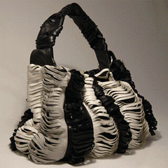 upcycled fringe leather handbag