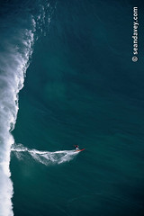 Fernando Ribiera tow surfing into a huge wave at Outside Avalanche, on the north shore of Oahu, Hawaii. (Sean Davey Photography) Tags: pictures usa seascape color green nature vertical glitter photography hawaii big shiny energy surf glow power oahu wave alternativeenergy northshore curl swell shimmer whitewash cascading avalanche greenenergy greenpower oceanwave seawave alternativepower oceanswell northshoreoahu seandavey towsurf towsurfer oceanpower seaswell giantsurf photographyfineart finephotographyart curlingwave wavesenergy seawaveenergy oceanenergy oceanwavepictures seandaveyphotography seandaveyfineart