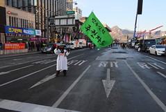 "Seoul Korea Kwanghwamun candle rally February 11 2017 with lone vuvuzela-tooting demonstrator - ""Tooting One's Horn"" (moreska) Tags: seoul korea kwanghwamun candle rally february 11 2017 demonstrator horn vuvuzela flag hangul unstaged candid street protest democracy freespeech socialchange impeachment currentevents history garb costume 광화문 capital cityscape 대한민국 rok asia"