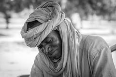 Niamey, Niger (gstads) Tags: niamey niger africa afrique sahel nigérien bw blackandwhite noiretblanc monochrome bnw portrait people man male headscarf turband shy african africain sahelian sahélien