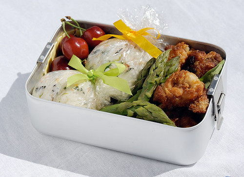 Chicken karaage lollipops and gift-wrapped onigiri bento