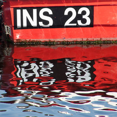 INS 23 Reflection (Donald Noble) Tags: light red colour reflection water scotland boat marine harbour ripple text moray lossiemouth tncwc tncwc81