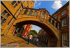 Hertford Bridge, Oxford, England ~ Bridge of History...~ (david gutierrez [ www.davidgutierrez.co.uk ]) Tags: new old city uk bridge blue sky people urban building history college colors architecture clouds buildings spectacular geotagged photography design photo arquitectura cityscape image sony centre cities cityscapes bridges center structure architectural 350 oxford architektur sensational metropolis bridgeofsighs alpha impressive dt municipality edifice cites hertfordbridge newcollegelane f4556 sirthomasjackson 1118mm sonyalphadt1118mmf4556 sony350dslra350