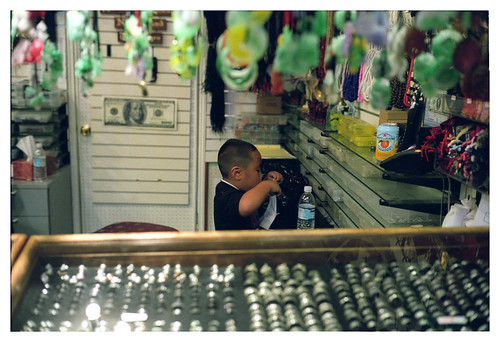Child at the market. Voigtlander Bessa R3A + Nokton 40mm f/1.4 SC + Fujicolor Pro 400H