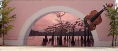 """Horizons"" mural by Robert Dafford (Kim Dever Thibodeaux / Kim_in_CajunCountry) Tags: trees art mural louisiana lafayette violin cypress cajun acadian picnik acadiana canon28135mm canonef28135mmf3556isusm robertdafford kimthibodeaux kimdeverthibodeaux pullfoliomisc kimincajuncountry"