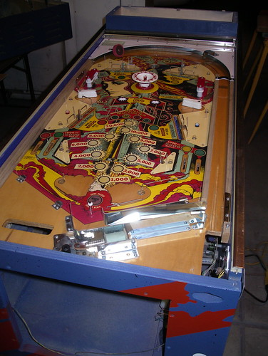 laying the playfield into the cabinet