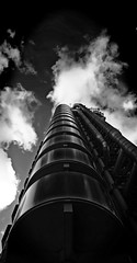 Industrial City (Aaron Yeoman [Old Account]) Tags: city uk greatbritain england sky urban blackandwhite bw reflection building london tower metal architecture modern clouds reflections europe steel sony pipes perspective highrise gb rogers a200 insurance lloyds cityoflondon finance bovis lloydsbuilding richardrogers lloydsoflondon onelimestreet sonya200 theinsideoutbuilding