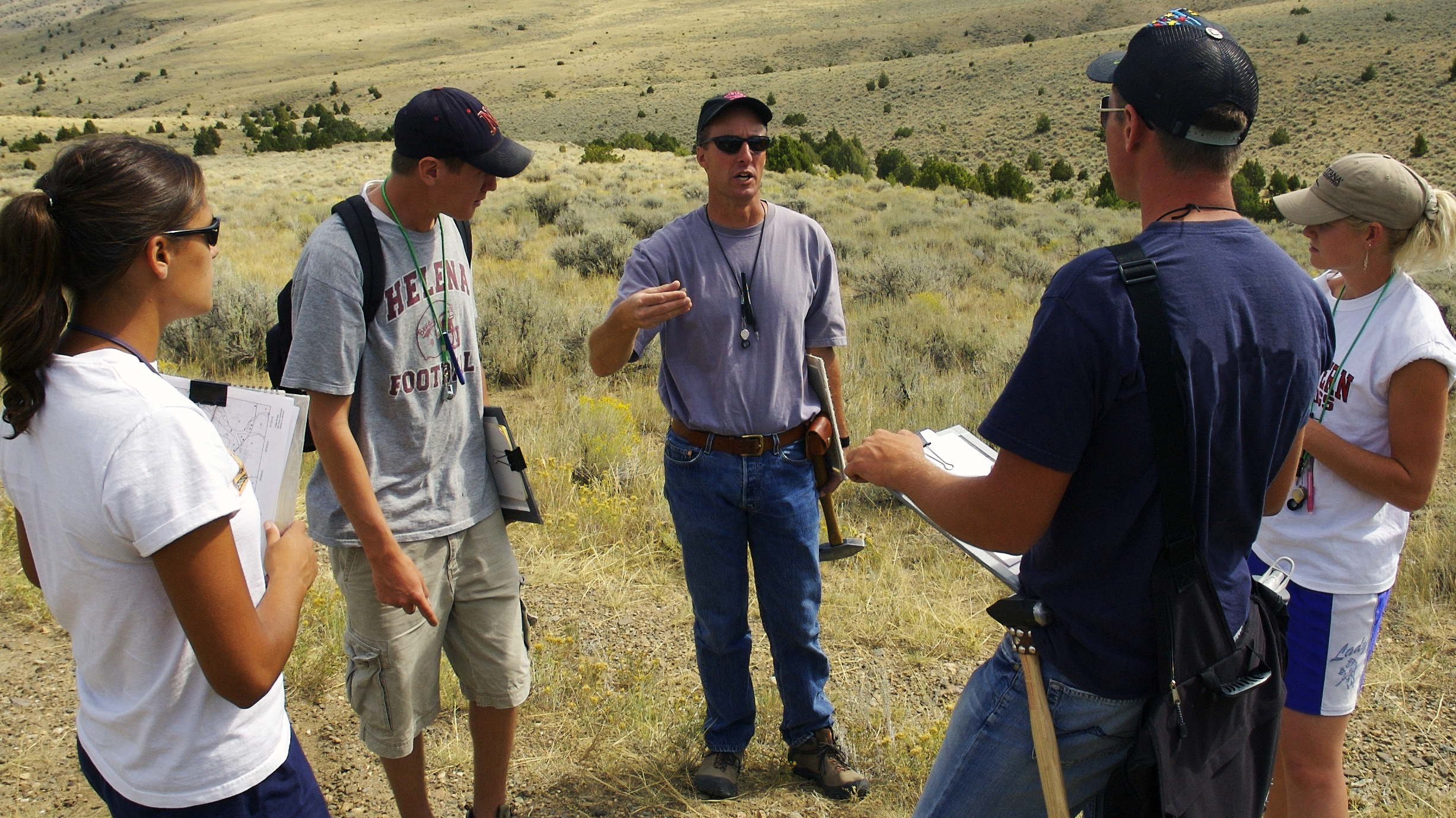 Professor Rob Thomas visiting with students in the field