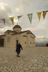 woman and church (Thalia Nouarou) Tags: winter fall greece arkadia peloponnese nikond60       thalianouarou   wwwthalianouarouwebscom wwwepathlogr