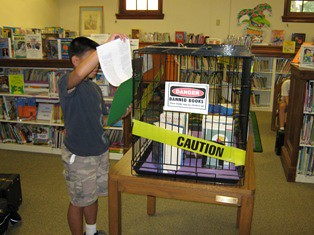Boy at caged books display