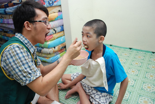 Kok Sheng and the Kid at YRJS Handicapped Children Association