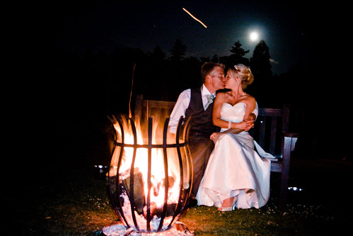Bride, groom, fire and moon