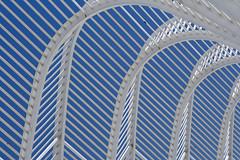 Calatrava's Agora - Athens Olympic Complex (Scott Norsworthy) Tags: blue santiago sky sculpture white 2004 architecture steel athens greece covered calatrava olympics shelter curve pathway agora