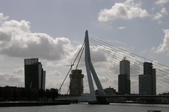Mixed skylines (Hélder Cotrim) Tags: netherlands rotterdam nederland olympus forgotten holanda paysbas less weak niederlande erasmusbridge paesibassi нидерланды ολλανδία menosinteressante