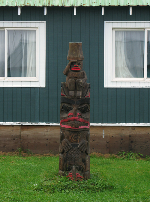 wet totem in front of Claude Morrison's house, Hydaburg, Alaska