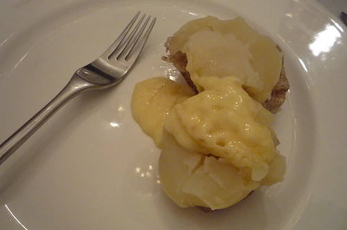 Raclette cheese over boiled potato