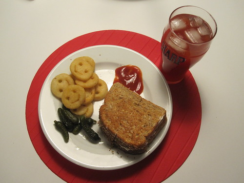Tuna sandwich, smiles, pickles, tomato juice