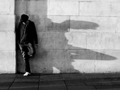 The Smoker By The Wall (an untrained eye) Tags: shadow england man london topf25 hat topv111 topv555 topv333 candid topv999 streetphotography trafalgarsquare topv222 nationalgallery bandw smoker anuntrainedeye