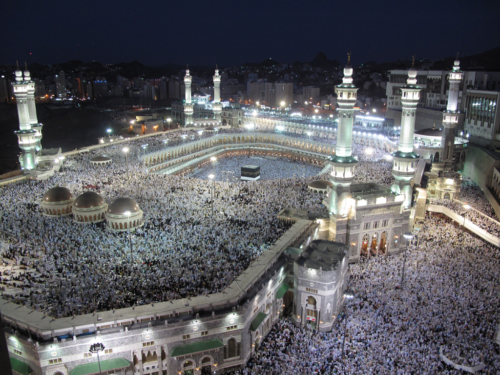 Hajj, Pilgrims, Mecca, Worshippers flood the Grand mosque, its roof, and all the areas around it during night prayers in Mecca.