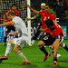 Michael Bradley chases out for the ball as Ahmed Al Muhamadi & Ahmed Hassan chases him