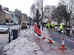 Emergency repair to pavement due to frost damage. (ScotiaIsles) Tags: winter urban snow streets ice weather tarmac scotland frozen january slush paving environment whitechristmas climate thaw linlithgow scots globalwarming slabs severeweather westlothian scotsman frostdamage salting snowclearing frostheave slipandfall severefrost moresnowinscotland whitechristmas2009westlothian winterroadmaintenance unclearedsnowandice maclaysofairdrie caithnessslabs historicweatherexpertwitness snowwestlothian