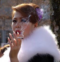 Smoke (Nicote) Tags: winter portrait woman flower girl japan hair outside japanese kyoto cigarette smoke january nails enjoy fingernails smoker kami nicotine
