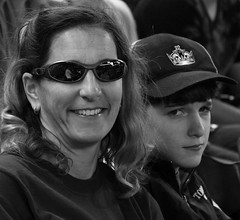 At the Game (Rennett Stowe) Tags: motherandson onemomentintime differentmoods baseballfans womaninsunglasses differentexpressions thepastisthepast atthegame differentpointsofview differentlooks happinessandsadness skepticallook motherandason womanandaboy smilingandfrowning imagemotherandson raisingteenagers alifegoneby picmotherandson motherandsonpic picmotherandteenageson varietyofexpressions