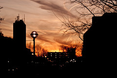 Contrails Galore! (ChongoIsDanegerous) Tags: above city light sunset sunlight black color up silhouette architecture buildings photography town photo high picture annarbor roofs arbor photograph shops ann dane ville hillard sonyalphadslra200 danehillard