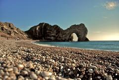 Durdle Door Pebbles (www.andyward.me) Tags: uk sea sun beach rock geotagged october rocks waves arch pebble dorset sunbathers lulworth lulworthcove durdledoor geo:lon=2278126 geo:lat=50622196