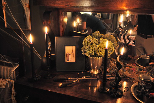 Spooky Sideboard with Black Candles and Vintage Cutlery