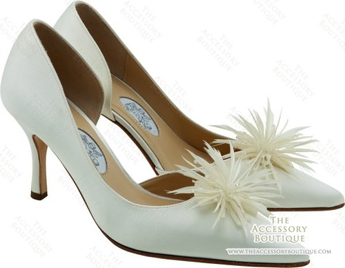 The feathers in wedding shoes touch.