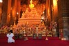 Praying woman (Benoit Rossignol) Tags: woman thailand temple gold golden bangkok buddha or praying panasonic g1 wat pho thailande doré