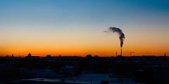 Sun is setting and smoke is running up (VesaM) Tags: sky finland helsinki balcony fi urbanlandscape stitchedpanorama