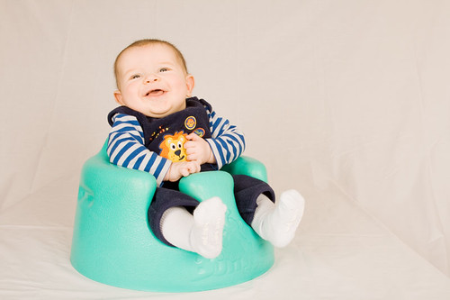 Owen posing in his Bumbo seat