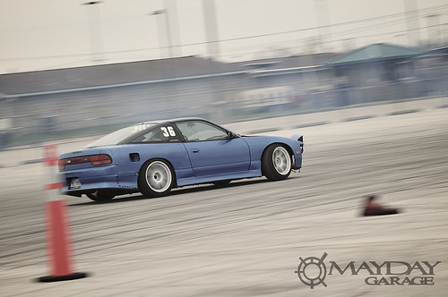 A simple blue colored S13 running the course.